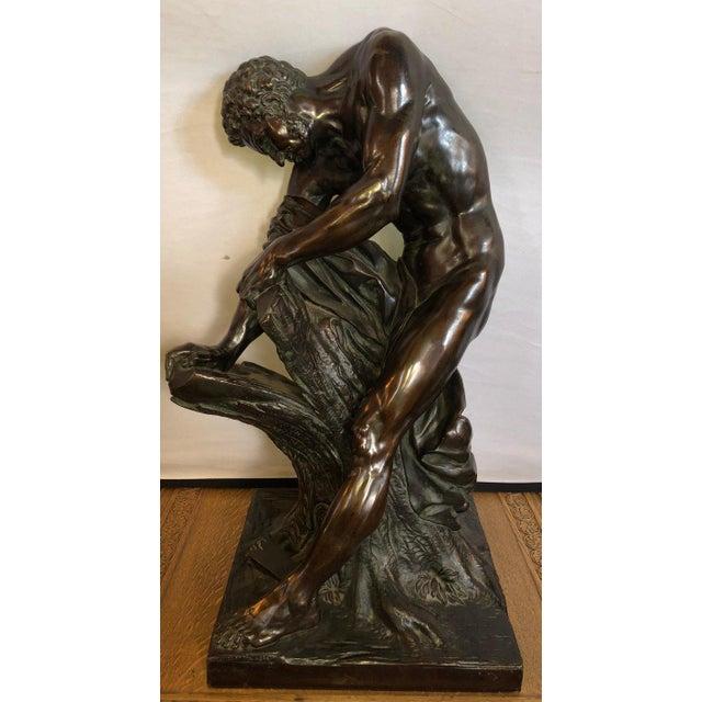 A late 19th century bronze after Edme Dumont's 1768 marble figure of Milo de Croton in the Louvre, Paris. This Palatial...