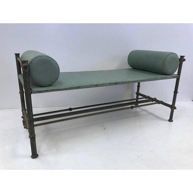 Industrial leather wrought iron bench. Bench has two removable cushions and the leather is hand-stitched. Leather is a...