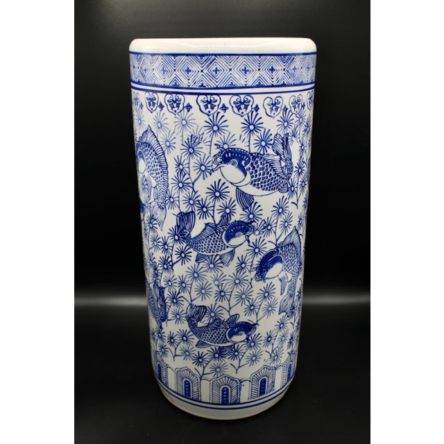 A superb ceramic Blue and White Chinese Umbrella Stand decorated with Koi Fish and detailed patterns. No maker's mark,...