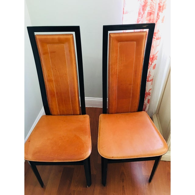 A Pair Roche Bubois Leather and black Lacquer Dining Chairs with High back. Elegant and Stylish! Exprertly finished and...