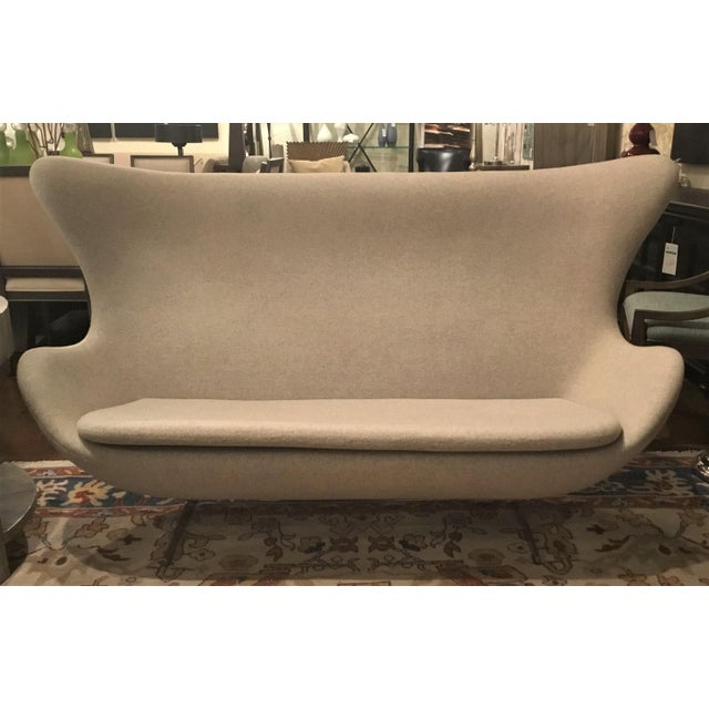 Stylish Mid-Century inspired Slattery Settee by: Control Brand, egg shaped frame upholstered in a light gray cashmere...
