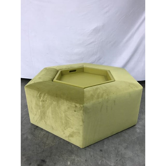 The Menil Cocktail Ottoman is a first quality market sample that features a Yellow Fabric with a Yellow Benjamin Moore Paint.