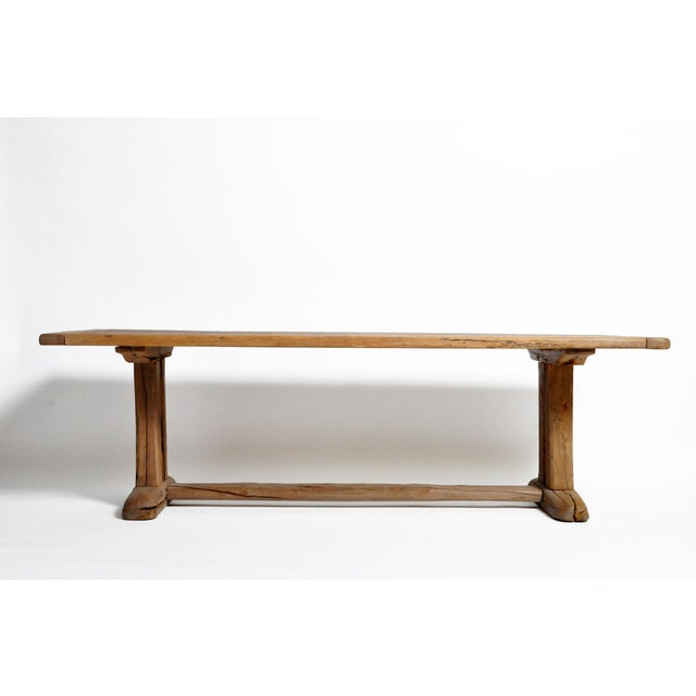 This rustic long farm table is from Switzerland and was made from oak wood, circa mid-19th century. The table features a...