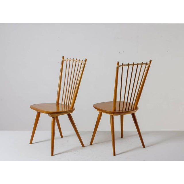 A pair of cherrywood chairs by Albert Haberer from circa 1950. The leather connection between the spindles is a beautiful...