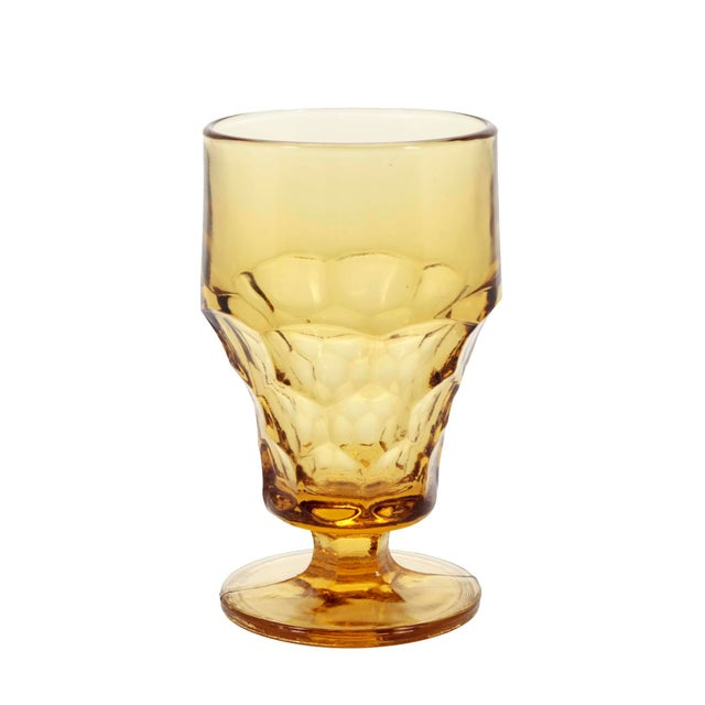 Set of 7 amber or dark topaz colored vintage Anchor-Hocking heavy glass footed 10 oz tumblers for water or iced tea....