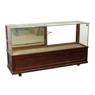 20th Century Early American Wooden Glass Front Showcase on Wheels Preview