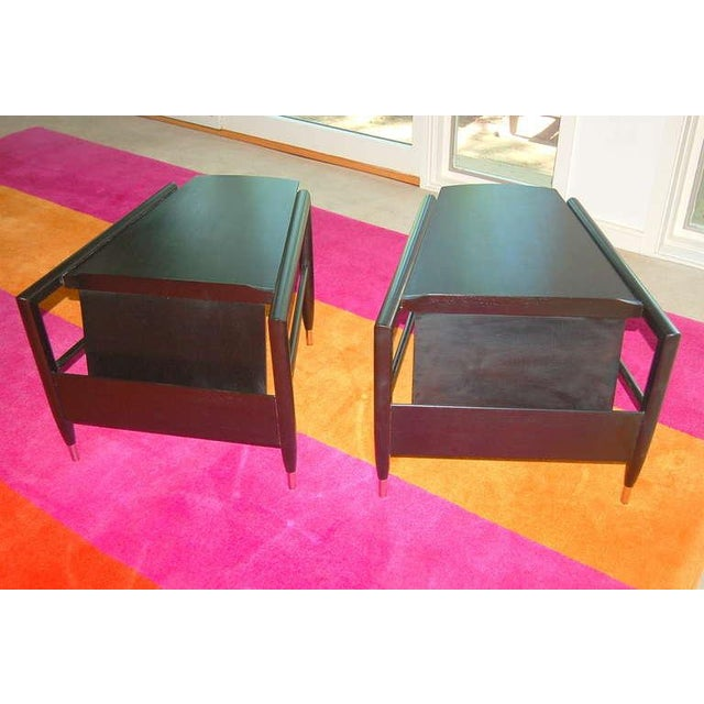 Called 'Wedge Table' because of their trapezoidal shaped top, this pair has been beautifully ebonized, the sabots have new...