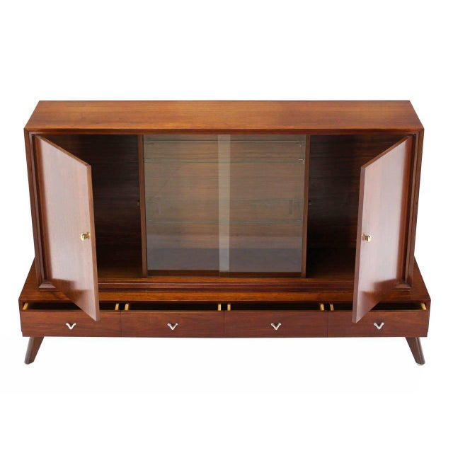 Unusual shape mid-century modern two part low china cabinet credenza.