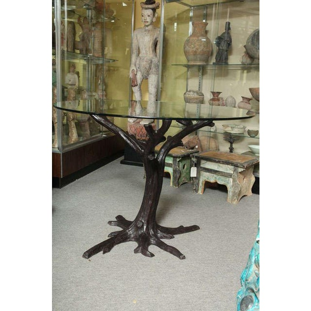 """A bronze contemporary tree-trunk shaped dining table base from Thailand, capable of supporting a top up to 54"""" in..."""