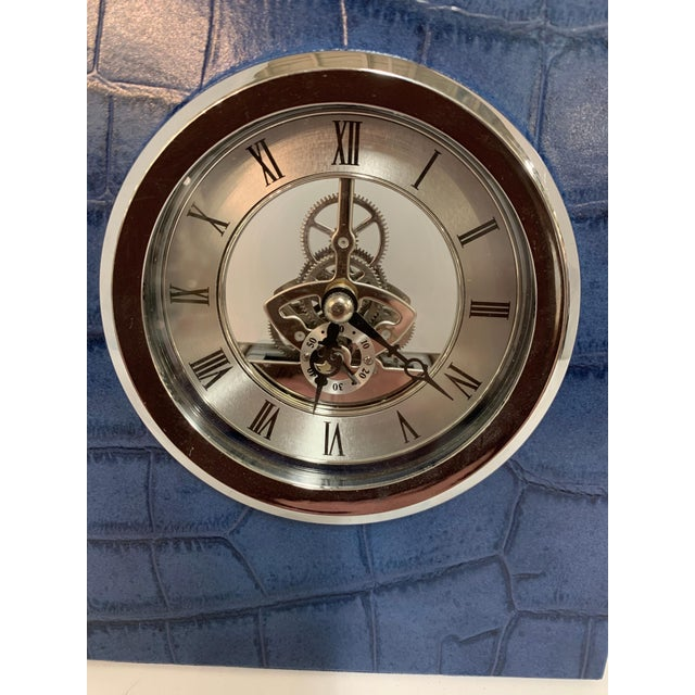 A simply beautiful clock in an alligator or crocodile grained leather by Renzo Romagnoli, the designer and purveyor of...