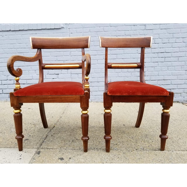Antique Neoclassical Mahogany set of 2 side chairs, one is an armchair, both have identical antique Silver and gilt trims....