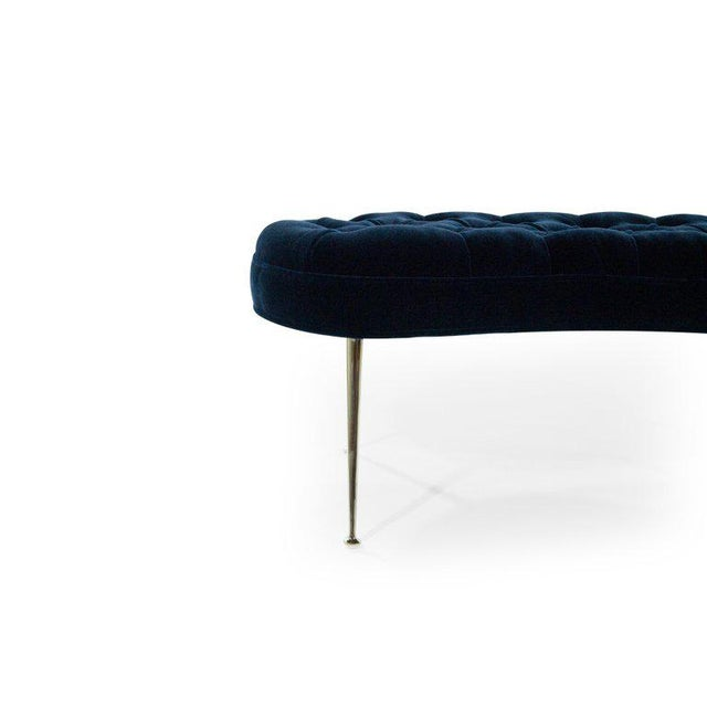 A fantastic pair of kidney shaped benches in tufted design, newly upholstered in midnight blue mohair by Donghia. Brass...