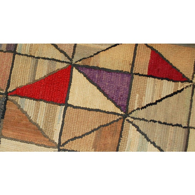 This is a handmade antique square American hooked rug in good condition. The rug has been made in a geometric design. It...