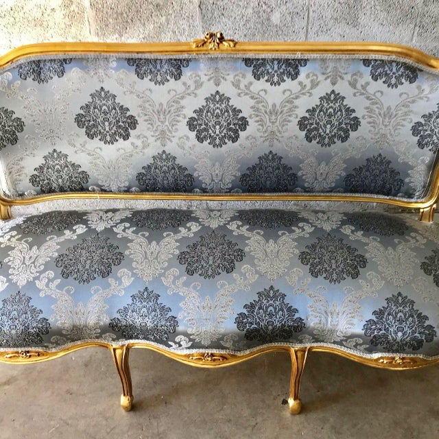 A wonderful French Louis XVI Sofa. The sofa was recently upholstered with blue and silver damask fabric and the massive...