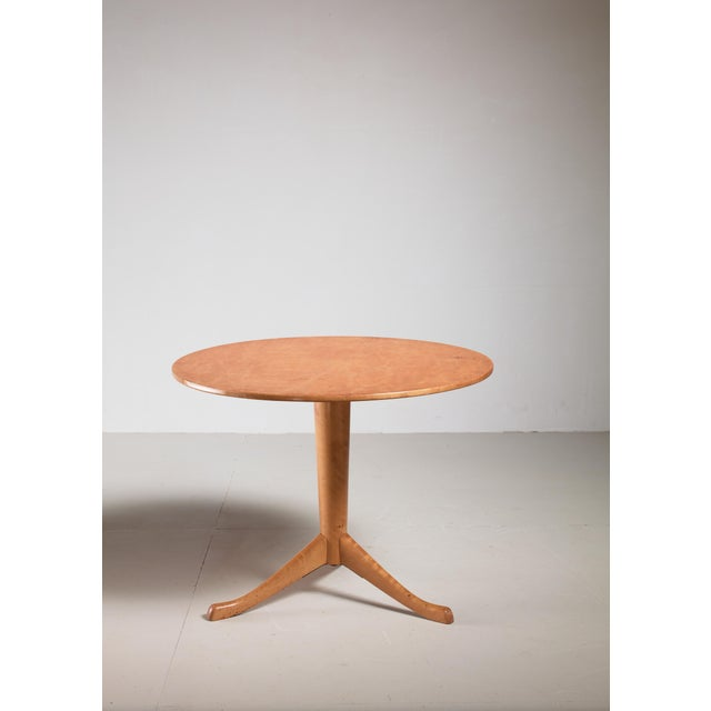 A round side or gueridon table by Axel Larsson for Svenska Möbelfabriken, Bodafors. The table has a tapering claw-foot and...