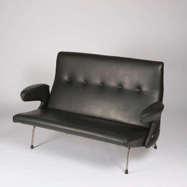 """Rare """"Delfino"""" sofa by Erberto Carboni for Arflex. Brass frame and details, original artificial leather."""