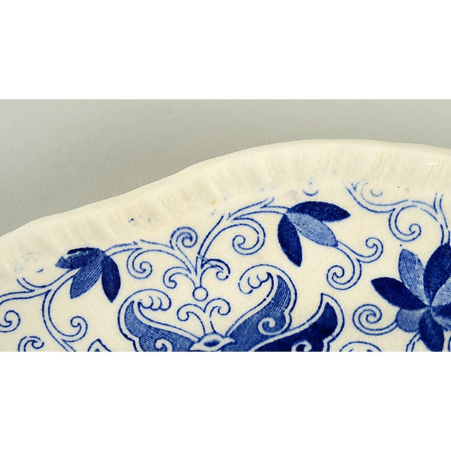 """Mason's Bow Bells Blue 13"""" Oval Serving Platter features blue transfer flowers and scrolls and an embossed scalloped edge...."""