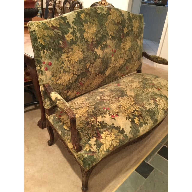Antique French walnut settee covered in Scalamandre Marly fabric. Forest green Marly fabric is cut and uncut velvet of...