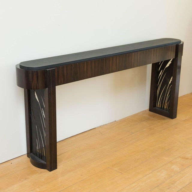 Black granite topped with Macassar ebony veneers and laser cut patinated steel insets. Handcrafted by master furniture...
