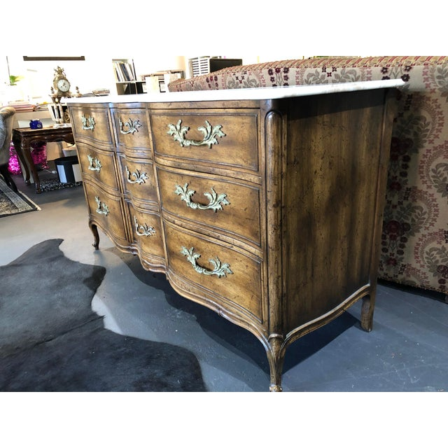 Exquisite French Provincial nine drawer marble top dresser. Very high quality and in excellent vintage condition. Most...