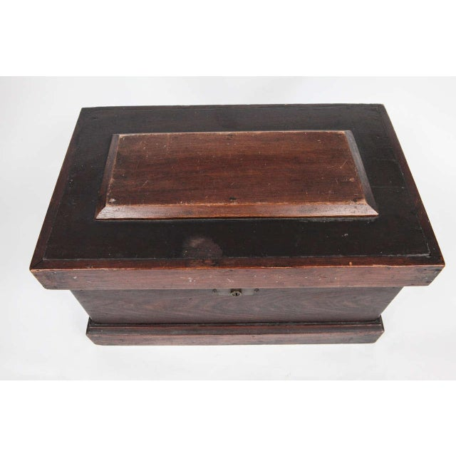 This carpenter's box has a stepped top and three removable trays. The box has brass hinges, lock and bracket and iron...
