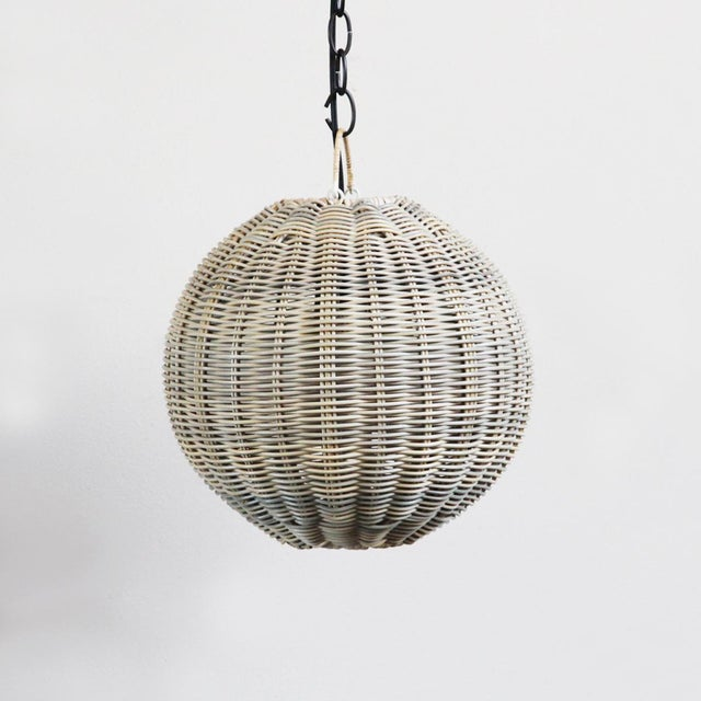 Faux rattan globe lantern with 12 inch diameter. Beautifully woven synthetic rattan with grey toned wicker appearance....