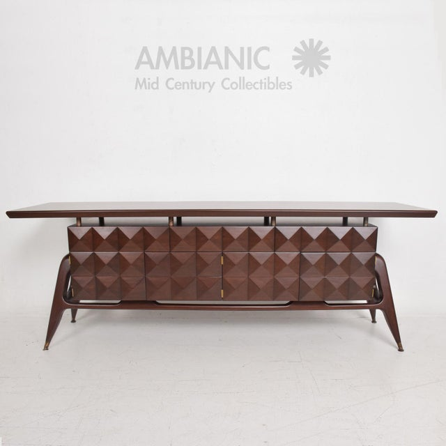 For your consideration a beautiful credenza in mahogany wood. Sculptural legs with brass sabots. The main cabinets...