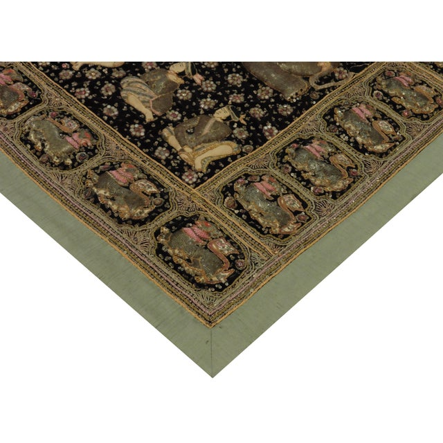 This is a beautiful embroidered Kalaga tapestry adorned with beads and sequins from Myanmar.