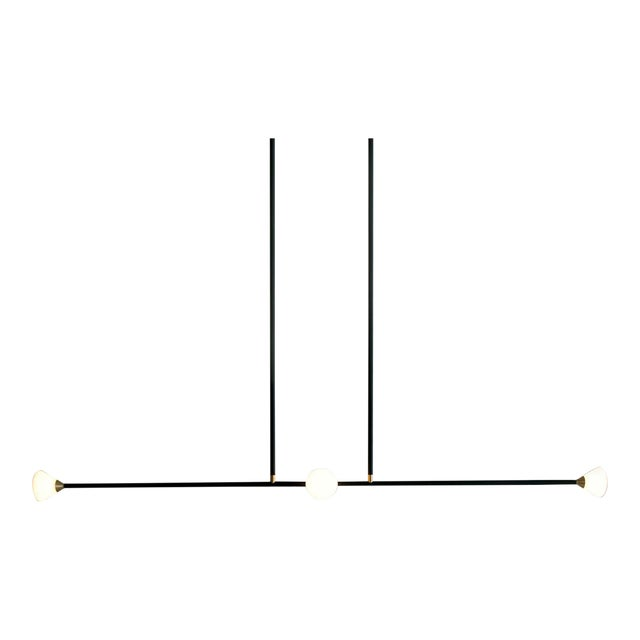 Opaque glass and brass shades seamlessly blend into a matte finish metal armature. The Apollo 4 features four triangular...