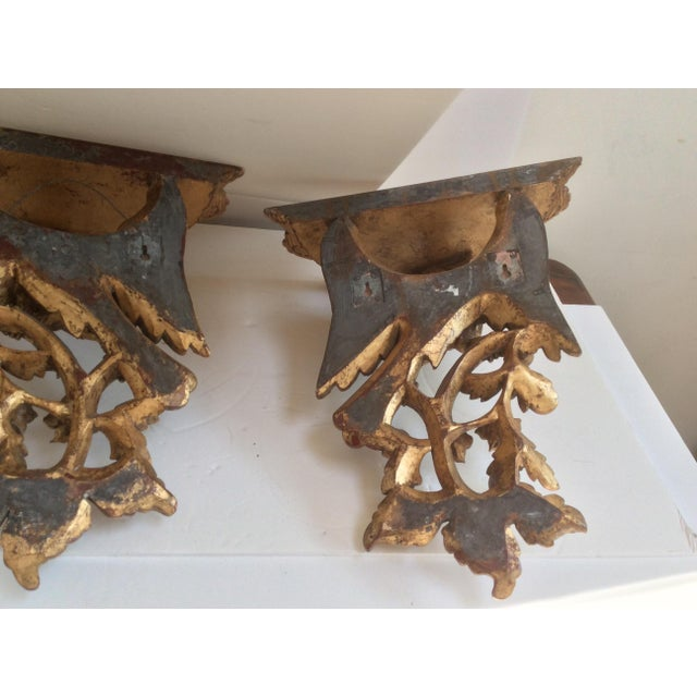 Pair of late 20th century carved wood with gold finish eagle Brackets or wall sconces.