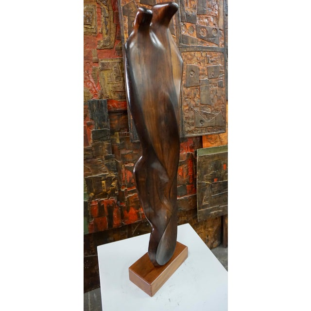 Organically shaped and beautifully executed freeform rosewood sculpture.Unknown artist,unsigned.