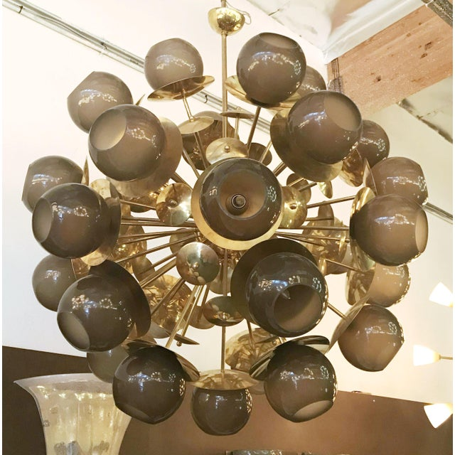 Italian Sputnik chandelier with smoky Murano globes on natural brass frame. Thirty lights / E12 type / max 40W each...