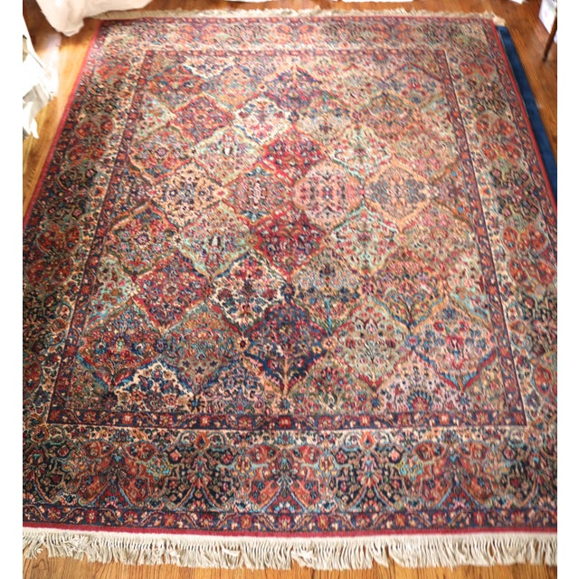"A beautiful multi-colored Kirman Rug by Karastan. The rug is 8.5' wide and 10.5' long with 3.5"" fringe. The pattern is:..."