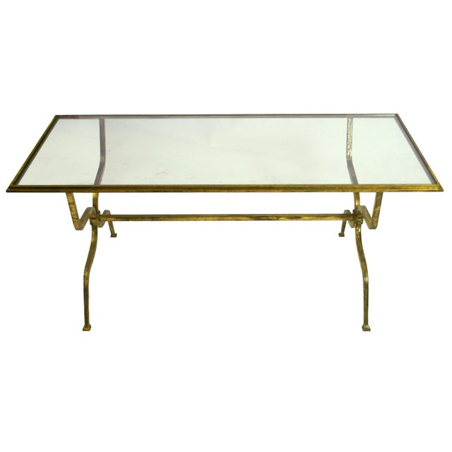 A Mid-20th Century Gilt-Iron and Glass Coffee Table by Maison Ramsay.