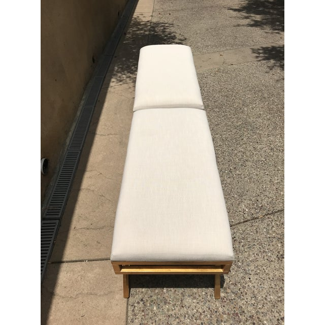 Pair of cream/gold/brass benches with upholstered top by Safavieh. Used for staging purposes only.