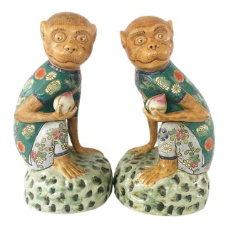 Vintage Pair of Chinoiserie Style Monkey Figures Holding Pomegranates - Pair Left & Right Facing For Sale