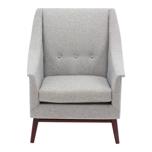 Danish Mid-Century Modern lounge chair newly upholstered in thick wood fabric. Solid oiled walnut base legs.