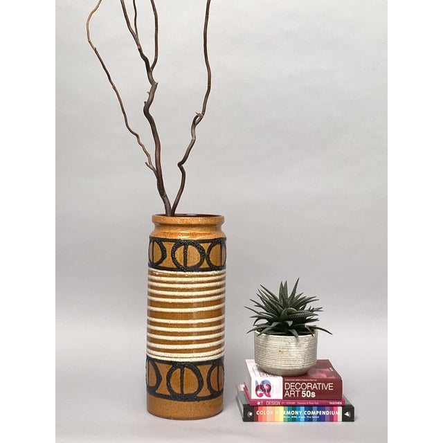 Mod and rustic West German pottery vessel sized as an umbrella holder or tall floor vase by Scheurich, West Germany. The...