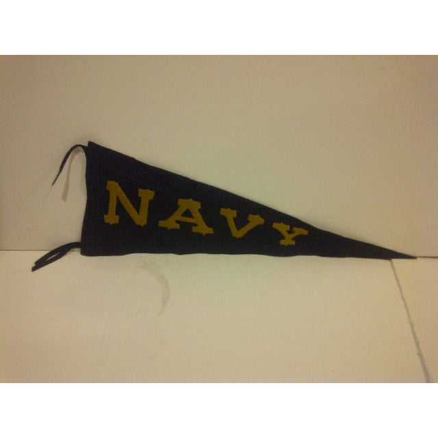 This is a vintage team pennant from the US Naval Academy, circa 1940. The pennant is vintage but in very good condition.