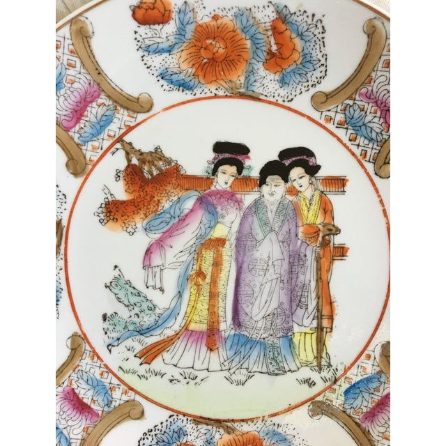 Lovely, colorful, mid century chinoiserie plate of three ladies. This plate is rimmed in gold. MADE IN CHINA on the...