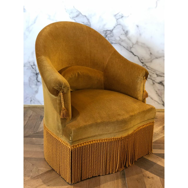 This 1940 gold velvet crapaud chair is the perfect petit accent chair. The chair features beautifully curved lines and...