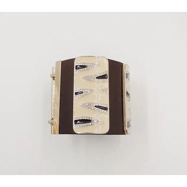 """1980s or 90s leather with 3 zebra stripe enamel plaques and rhinestone accents cuff bracelet with hook clasp. Marked """"V.""""..."""