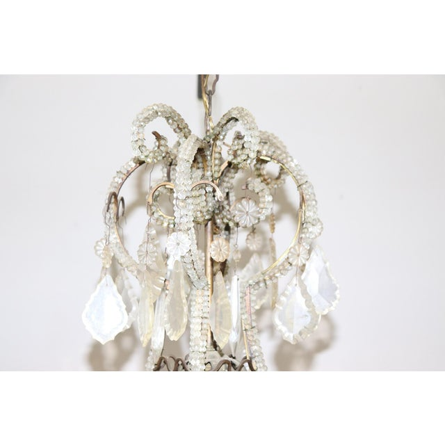 Beautiful and refined Italian Louis XVI style, circa 1880s chandelier nine lights. In bronze and completely covered drops...