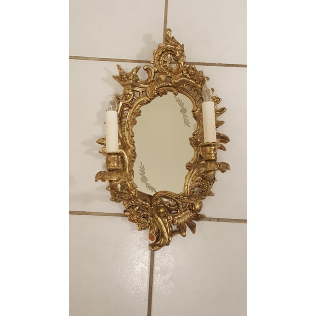 Thank you for stopping and taking a look of our gorgeous Pair of Antique Louis XVI Etched Gold Gilt-Bronze Mirrored...
