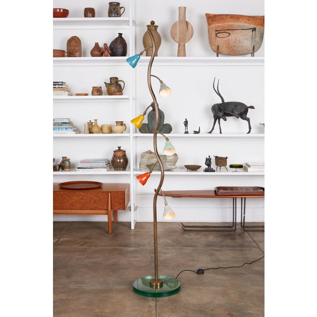 Tulip shade floor lamp, Italy, c.1960s. The lamp features a freeform shaped brass stem with a circular green glass base....