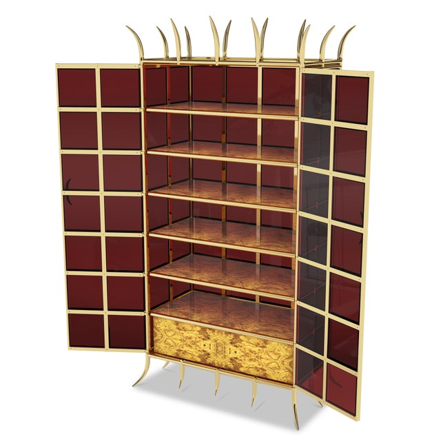 This contemporary cabinet is 100% custom made to order. It is made from solid brass and ruby red glass panels. It has...