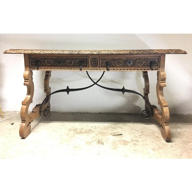 Spectacular 19th century walnut and wrought iron desk with two drawers. Beautiful unique brass metalwork on both drawers....