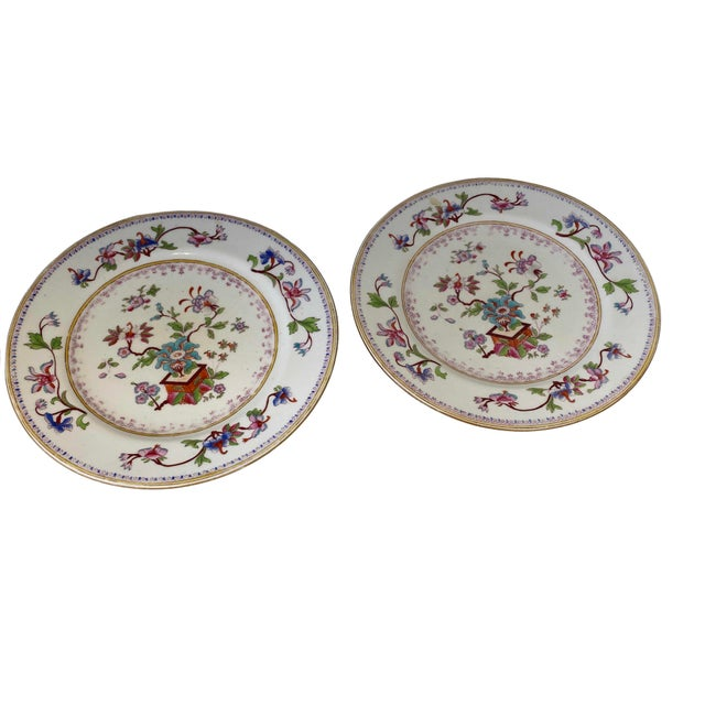 A pair of 19th century Chinese plates with aqua, pink, lilac flowers and gold trim.