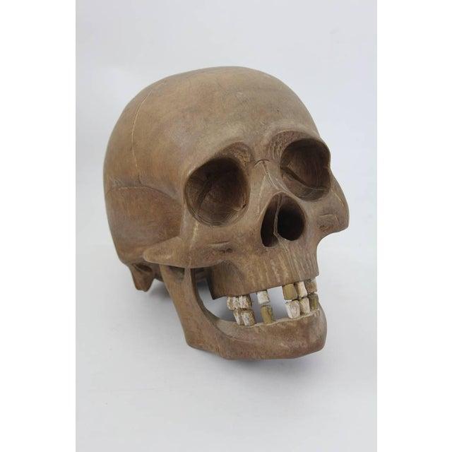Vintage hand-carved wooden skull.