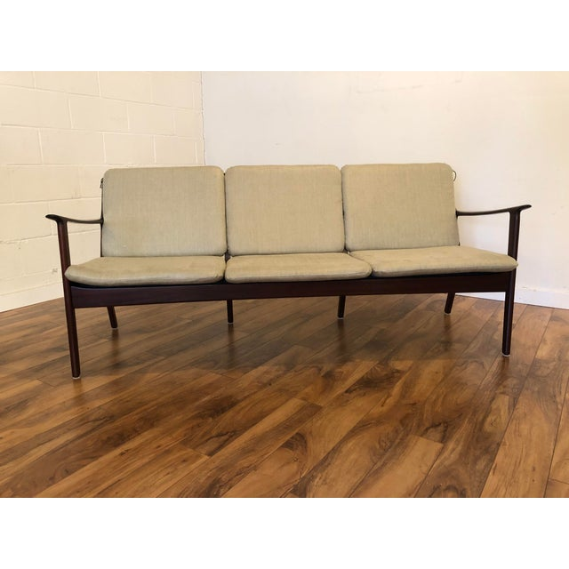 Vintage mid century modern sofa by Ole Wanscher for Poul Jeppesen. This couch offers an elegant look with mahogany frame...